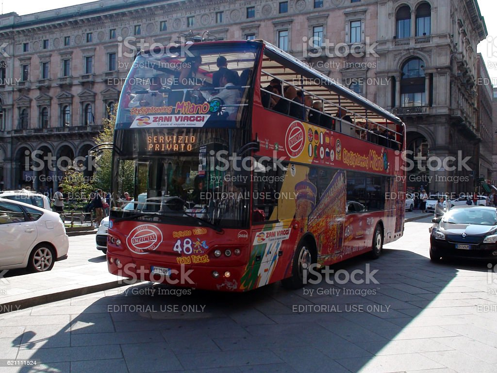 People Touring With Milan City Sightseeing Double Decker Big Bus stock photo