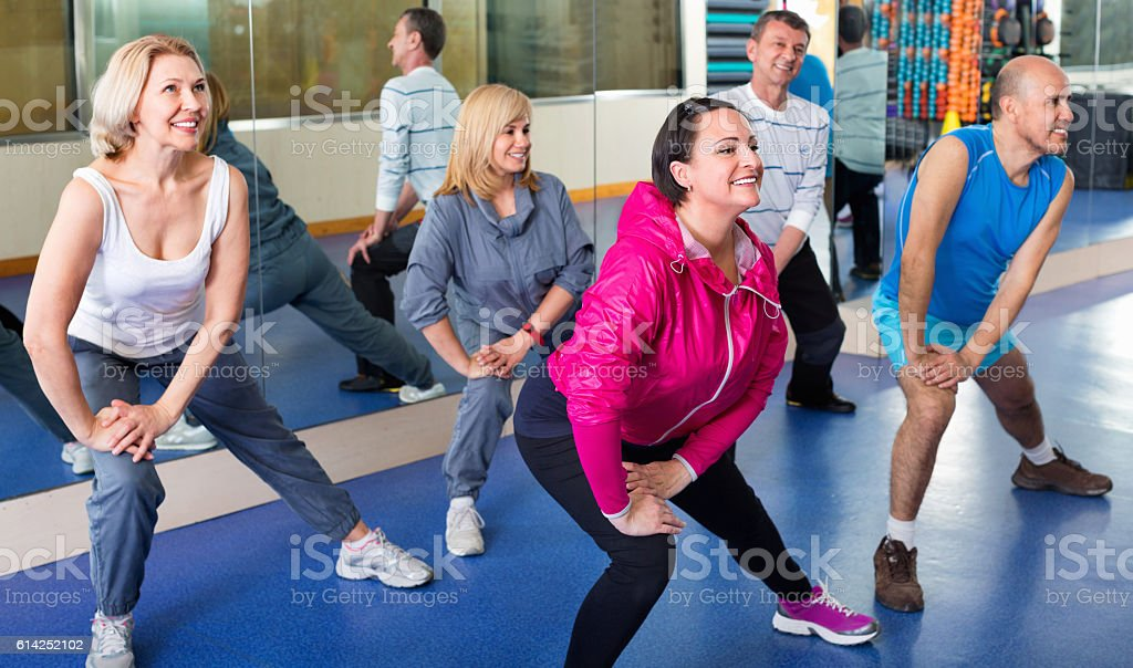 People training in a gym doing pilates stock photo