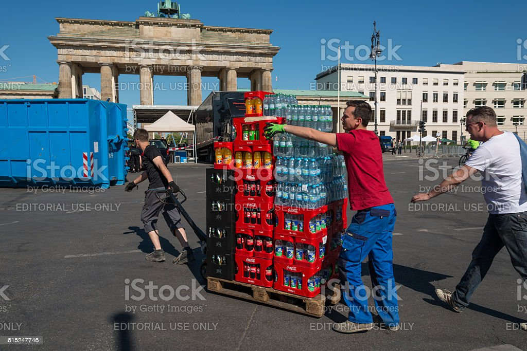 people transporting a europallet with water and Coca Cola stock photo