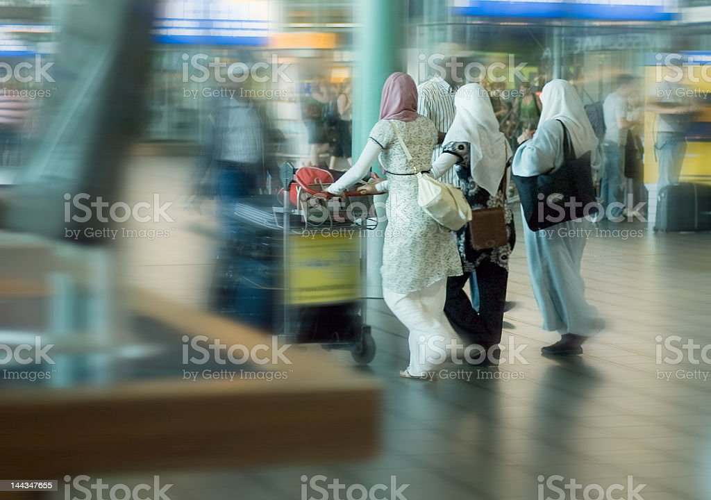 people traveling at the airport stock photo