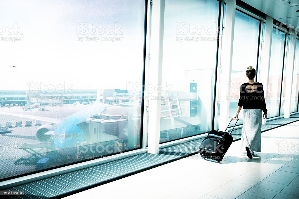 People traveling by airplane on summer holiday stock photo