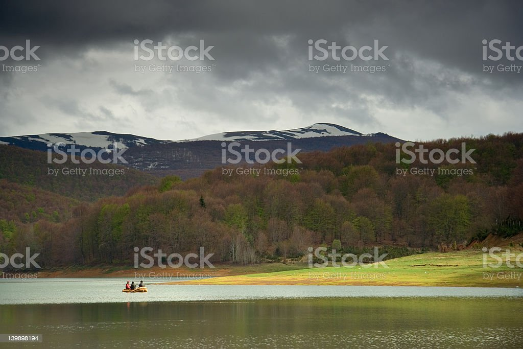 People traveling in a boat royalty-free stock photo