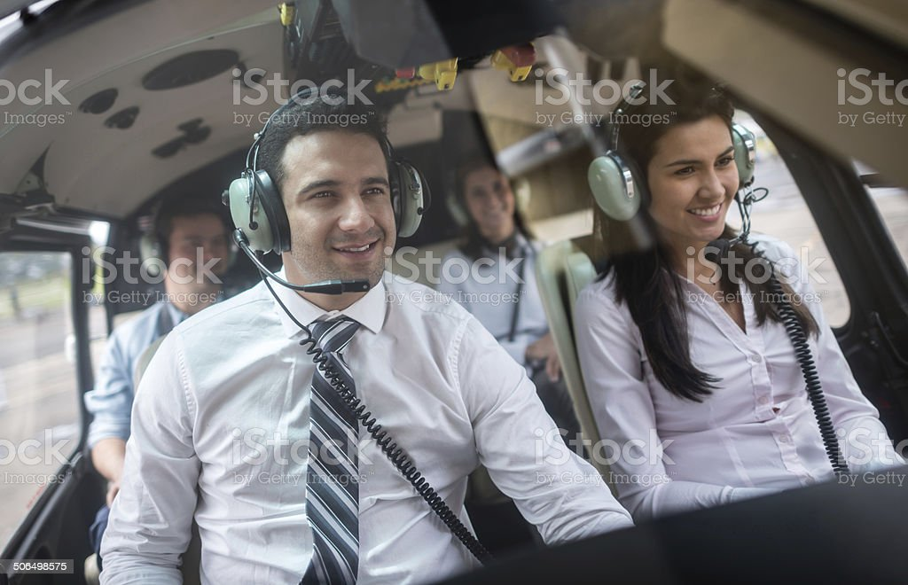People traveling in a helicopter stock photo