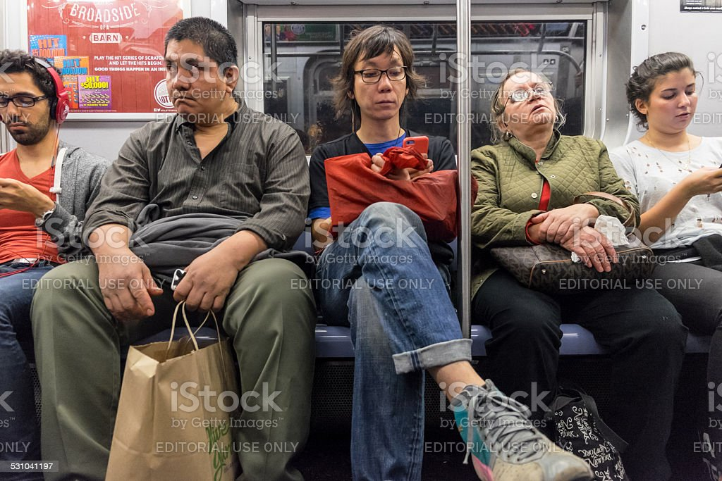 People traveling in a subway train in New York city stock photo