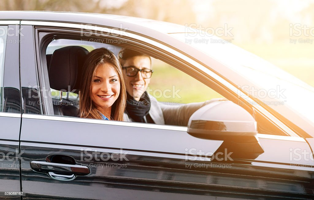 People traveling in luxury car on summer vacation and smiling stock photo