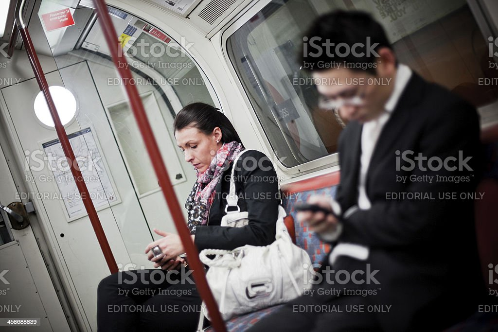 People traveling in the Tube London royalty-free stock photo