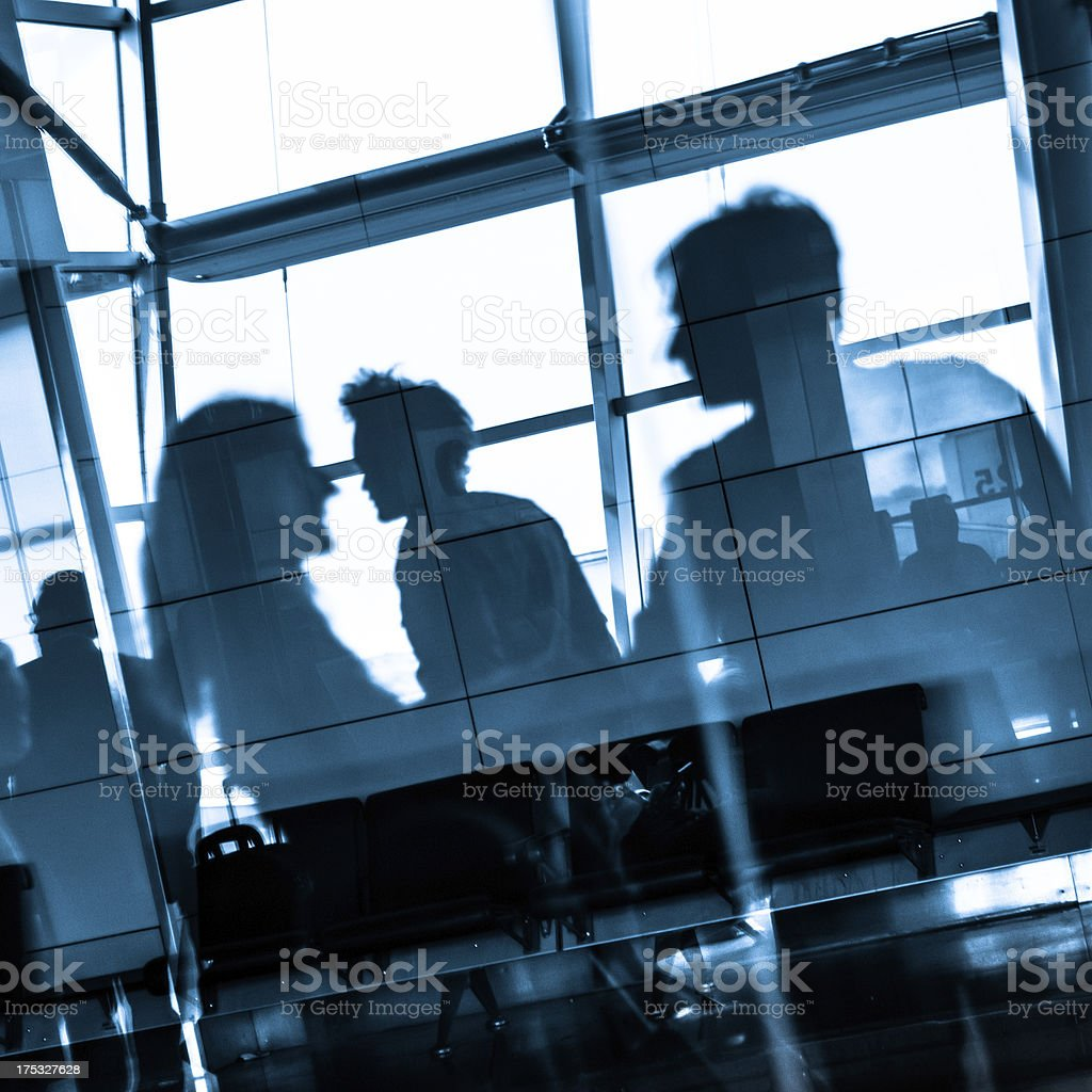 People traveling on airport silhouettes stock photo