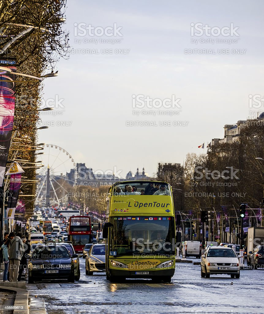 People traveling on Tour Bus, Paris, Champs-Elysees royalty-free stock photo