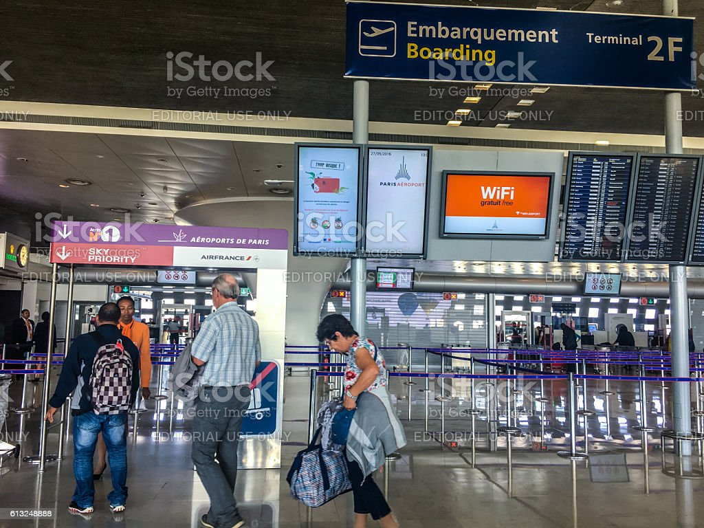 People traveling through Charle de Gaulle airport, Paris stock photo
