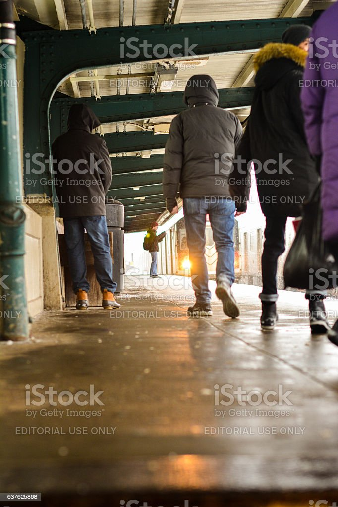 People traveling to manhattan at 40 st train satation queens stock photo