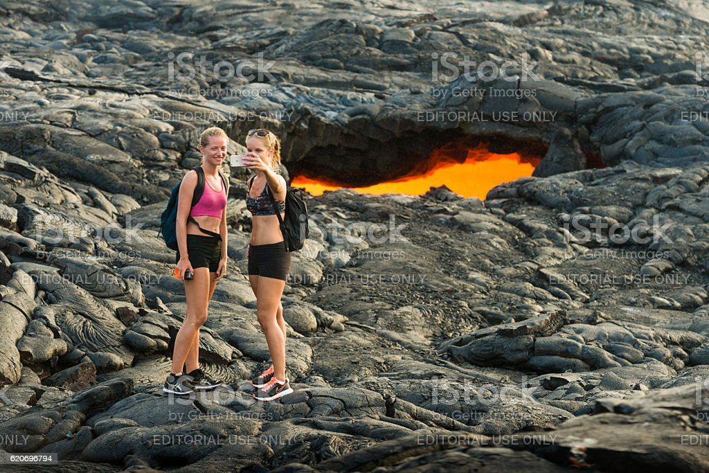 People Traveling to Volcanoes National Park Hawaii USA Taking Selfie stock photo