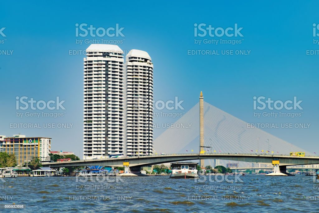 People travelling by boat in Chao Phraya river, Bangkok, Thailand stock photo