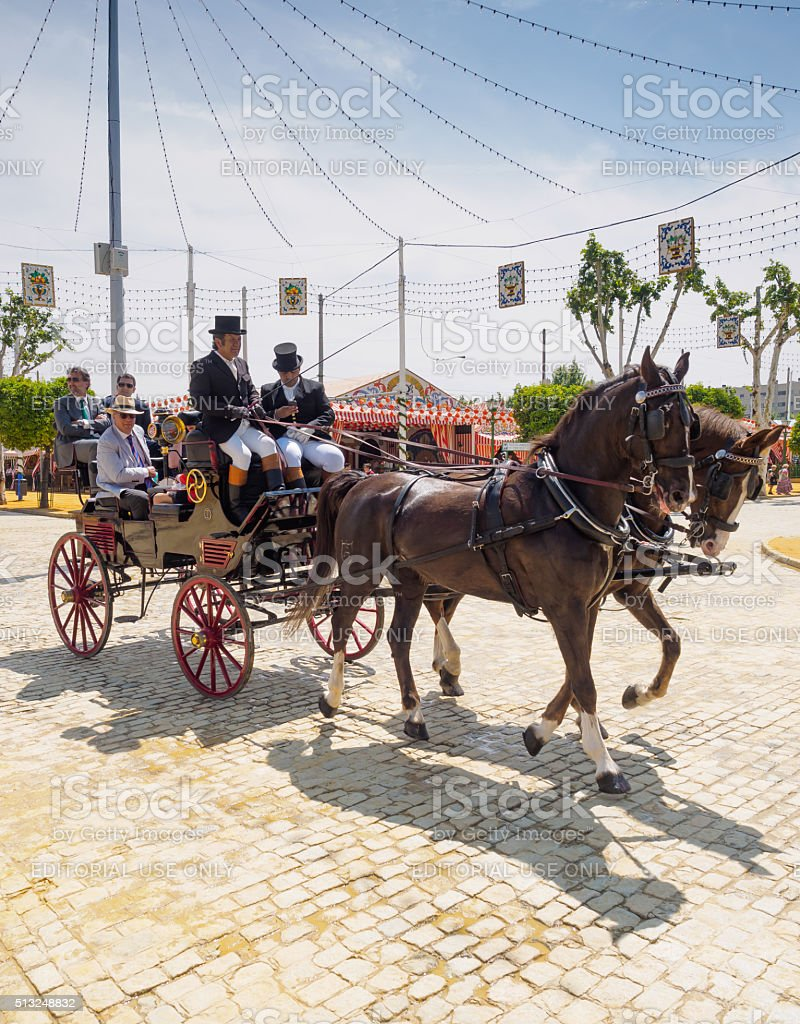 People travelling in a horse drawn carriage stock photo