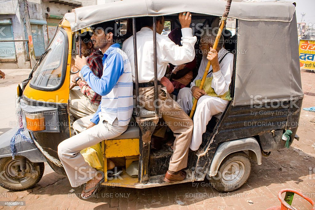 People travelling in a Overloaded Three Wheeler royalty-free stock photo