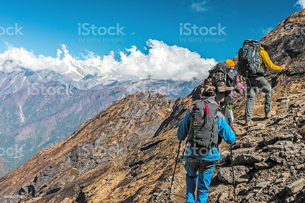 People travelling in Mountains on extreme Terrain stock photo