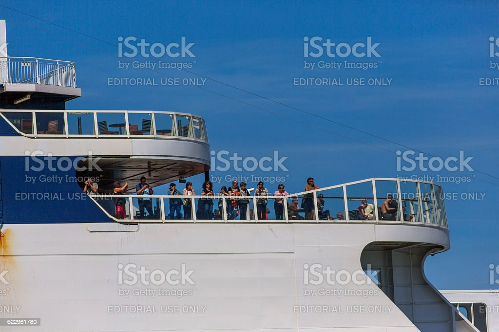 People travelling with ferry watching at coast of calais france stock photo