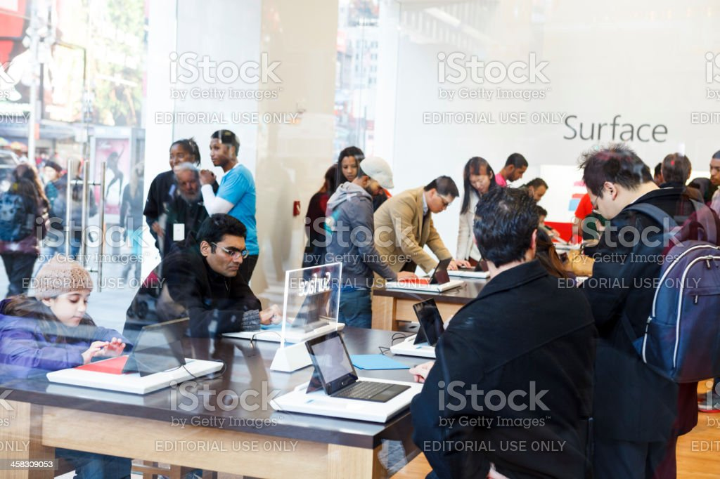 People Trying Surface Tablet in Microsoft Times Square Store Manhattan royalty-free stock photo