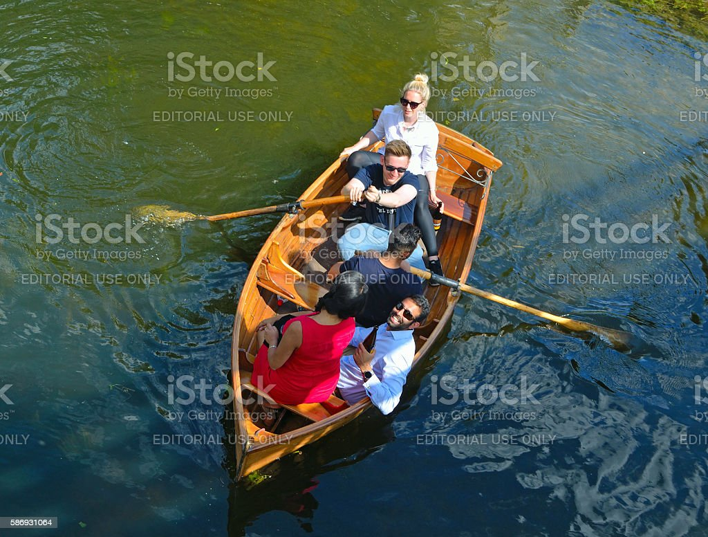People trying to row stock photo
