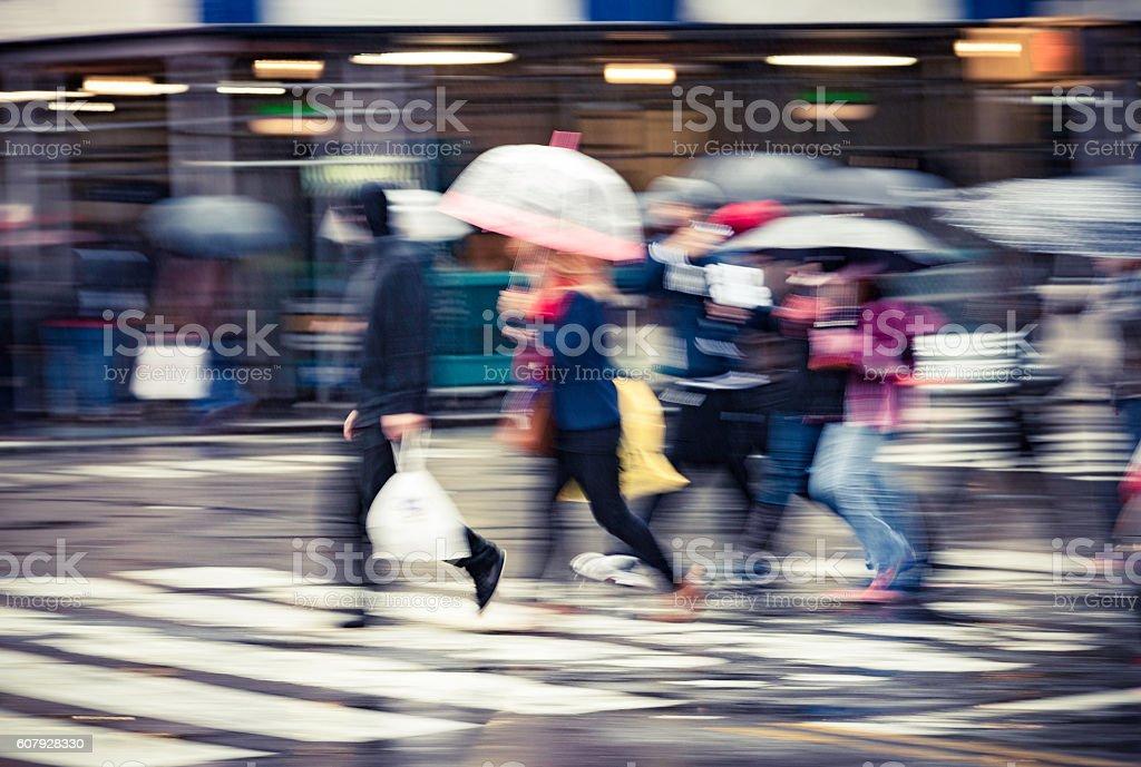 People, umbrellas, crossing street, wet, wintry New York City stock photo
