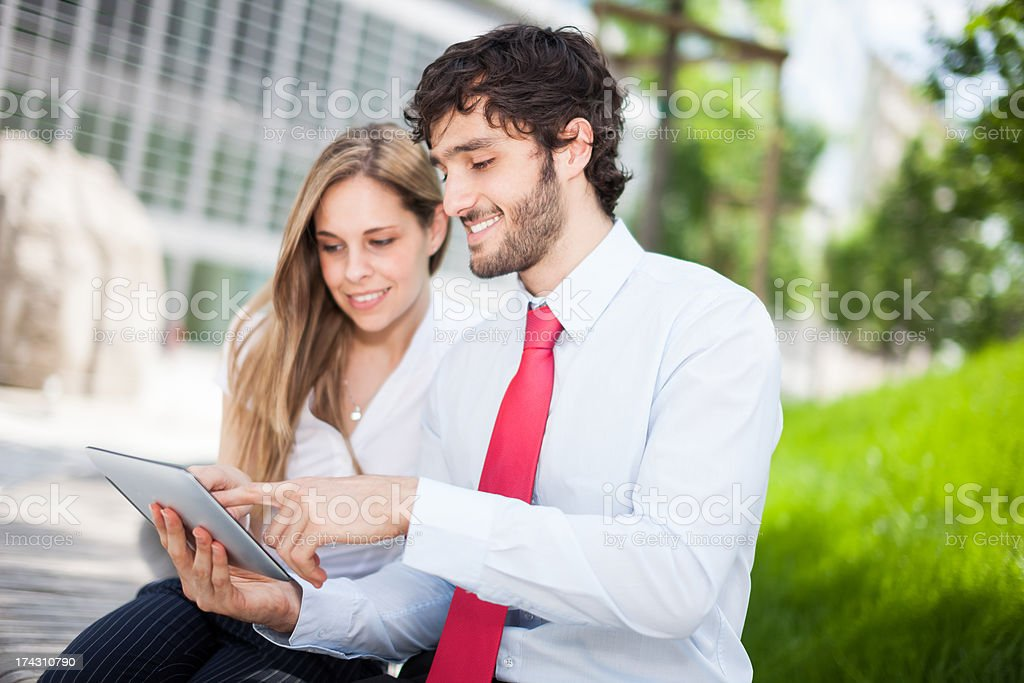People using a digital tablet royalty-free stock photo