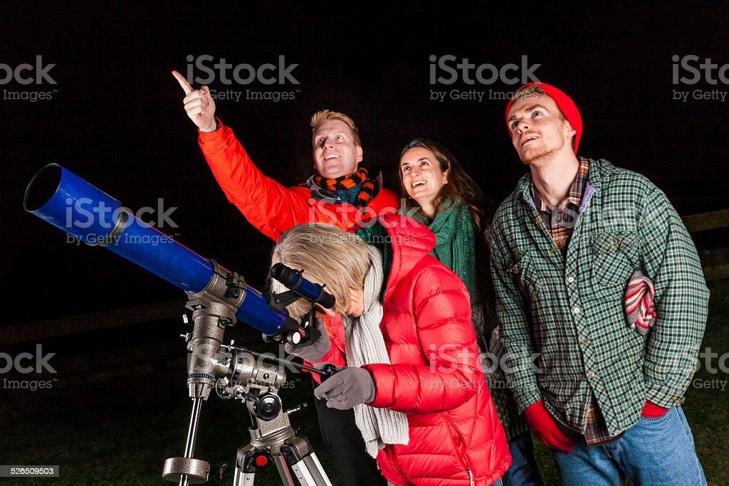 People using astronomical telescope stock photo