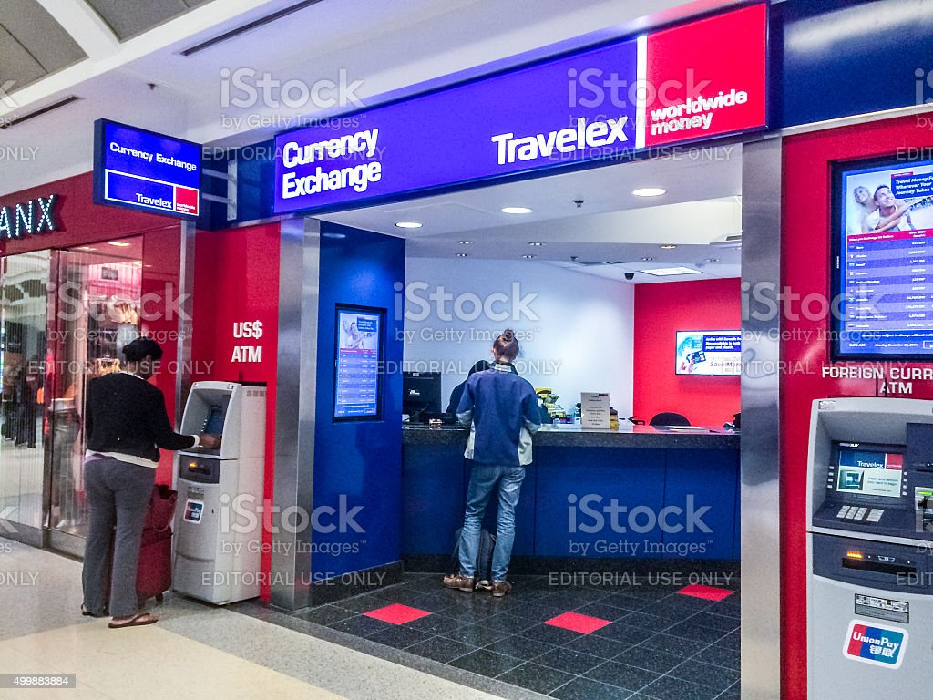 People using ATM and Currency Exchange at Atlanta Airport, USA stock photo