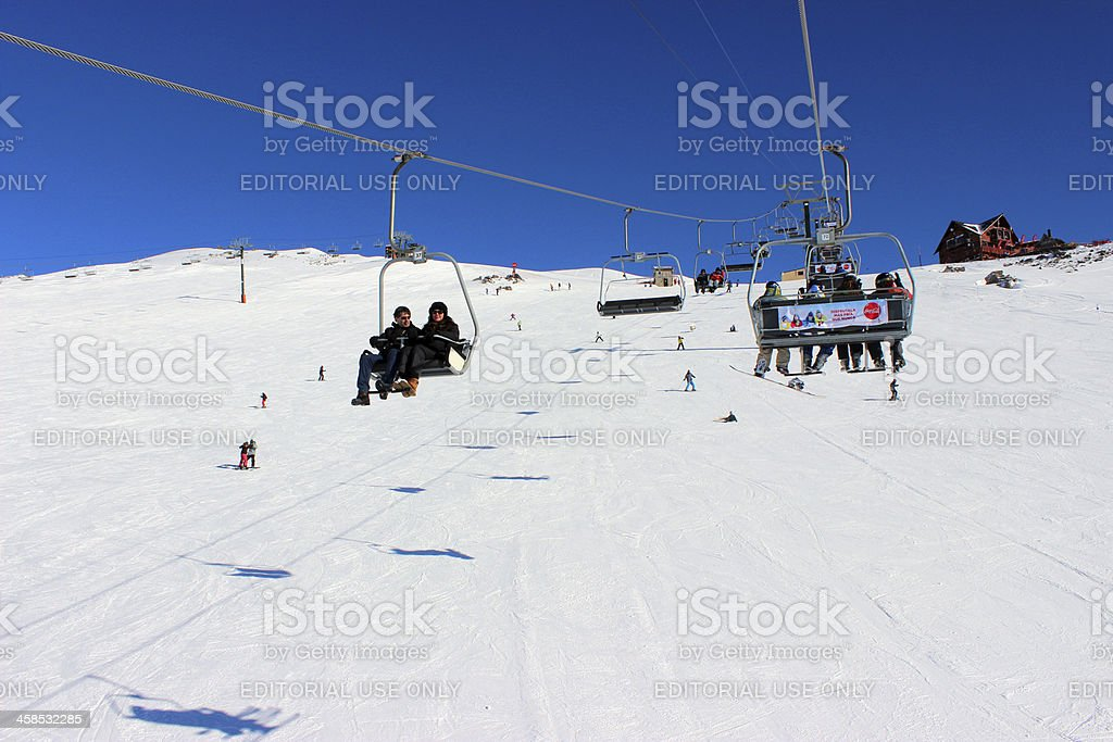 People using chair lifter at ski station CERRO CATEDRAL stock photo