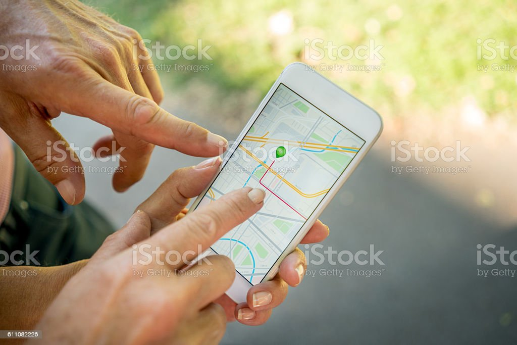 People using map apps on a mobile phone stock photo