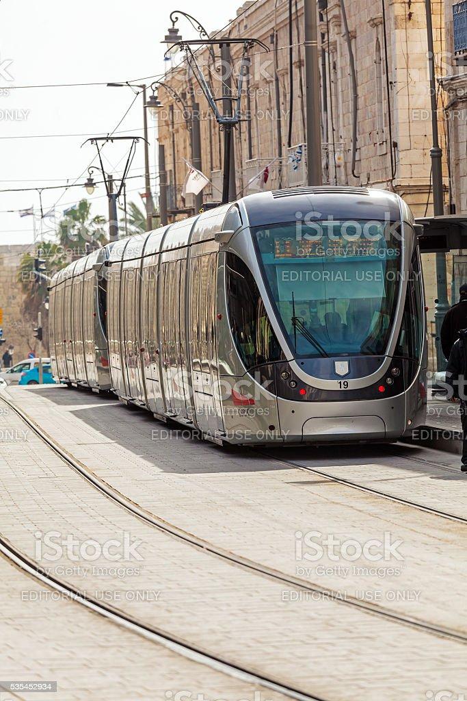 People using modern rapid tram stock photo