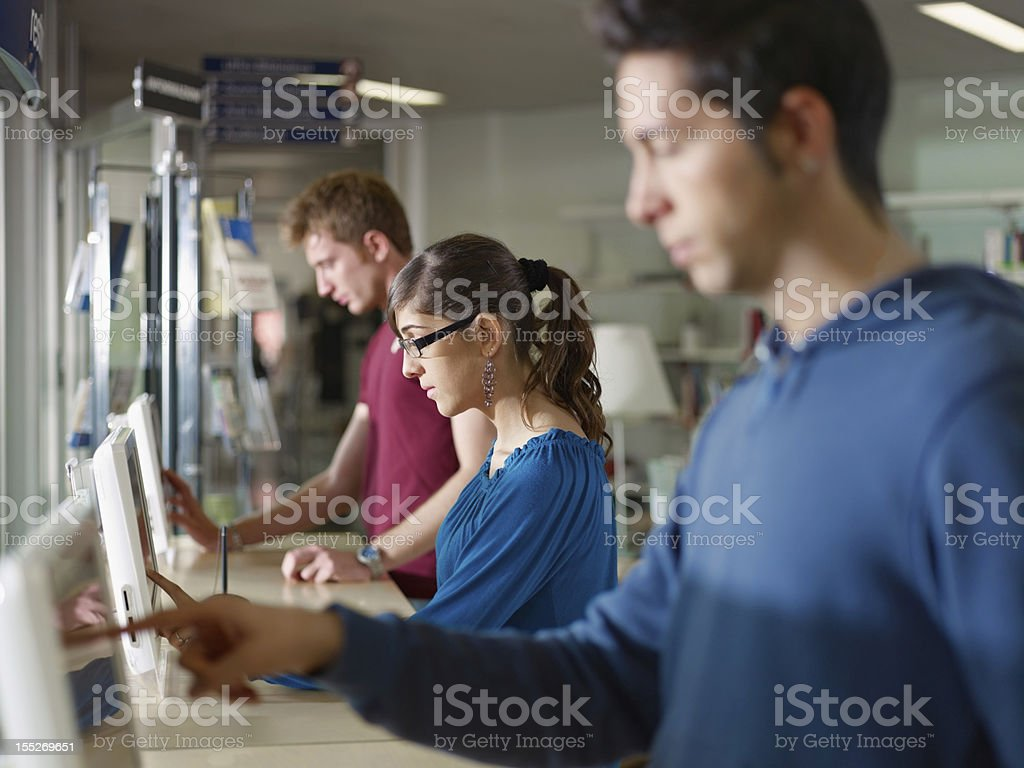 people using pc in library royalty-free stock photo
