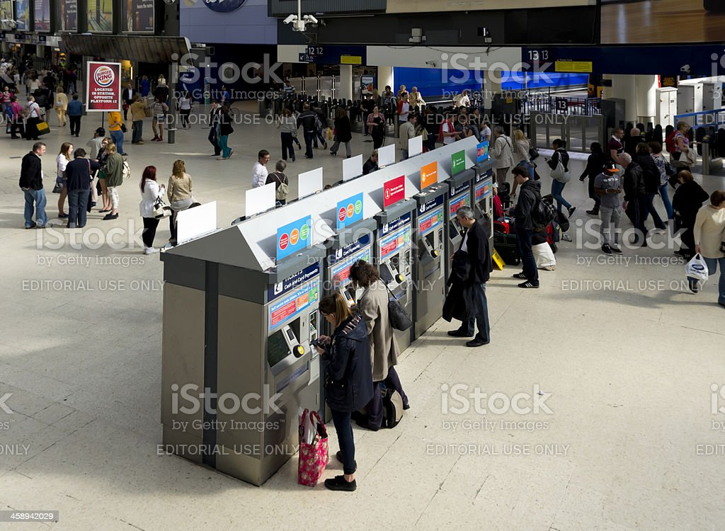 People using self service ticket machines at Waterloo Station royalty-free stock photo