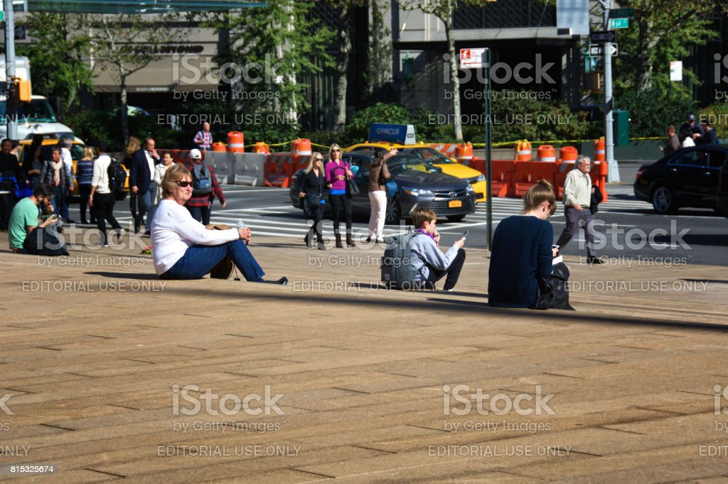 People using smartphones, Upper West Side of Manhattan, New York City, USA stock photo