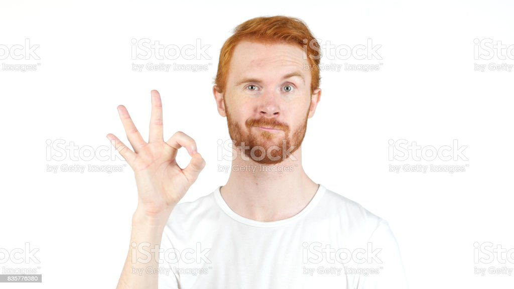 people, vision and success concept , showing ok sign , red hair man portrait stock photo
