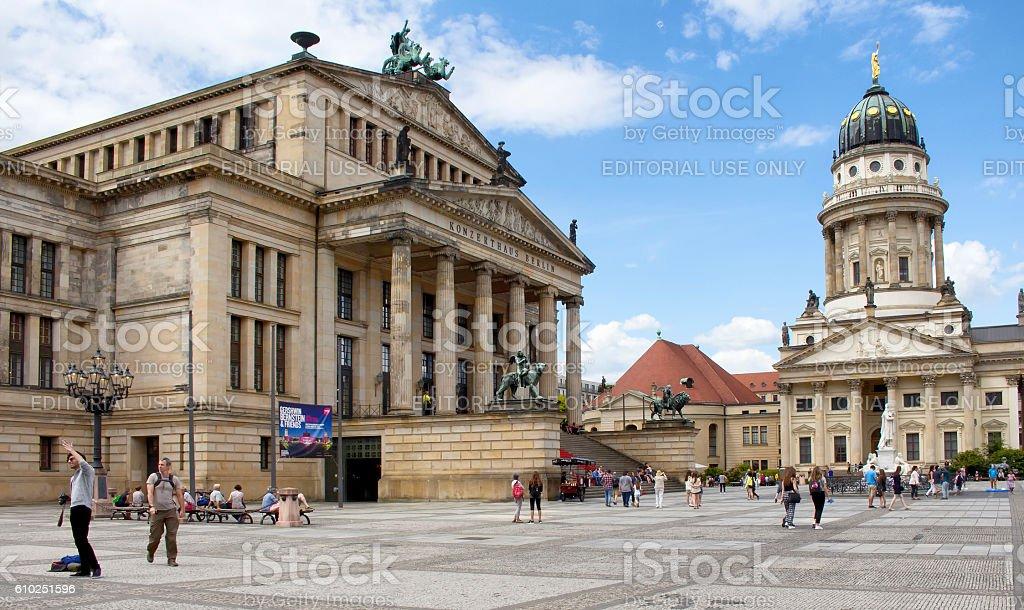 People visit and enjoy public square called 'Gendarmenmarkt' stock photo