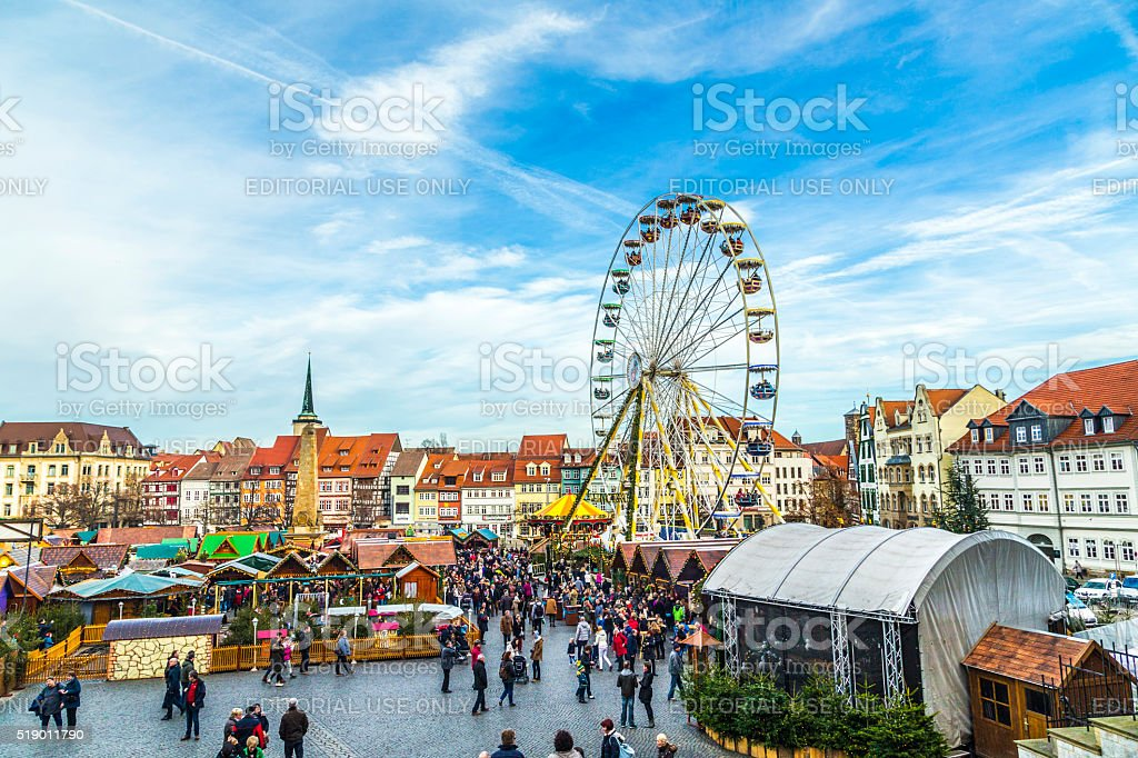 people visit big wheel at christkindl market in Erfurt stock photo