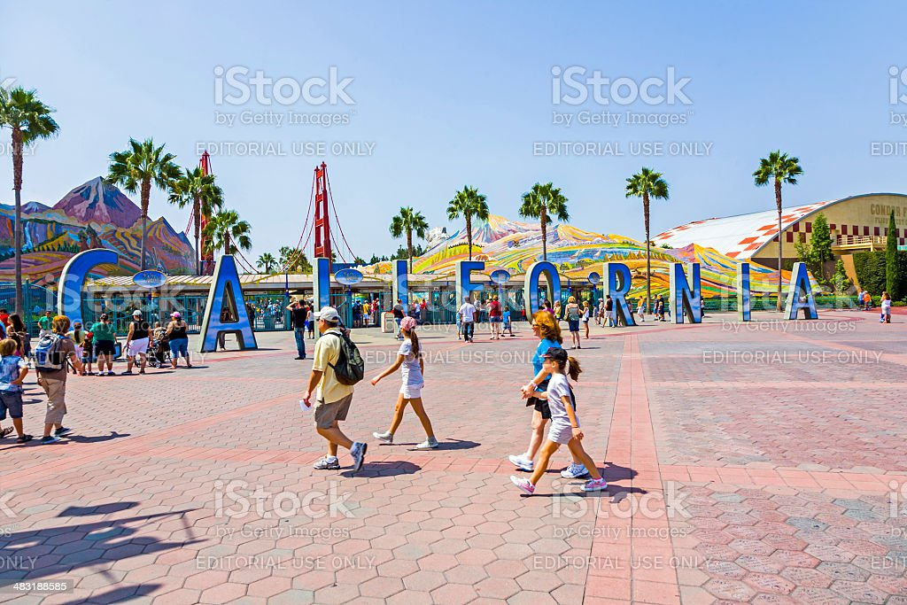 people visit disneyland and walk over commemorative bricks with stock photo