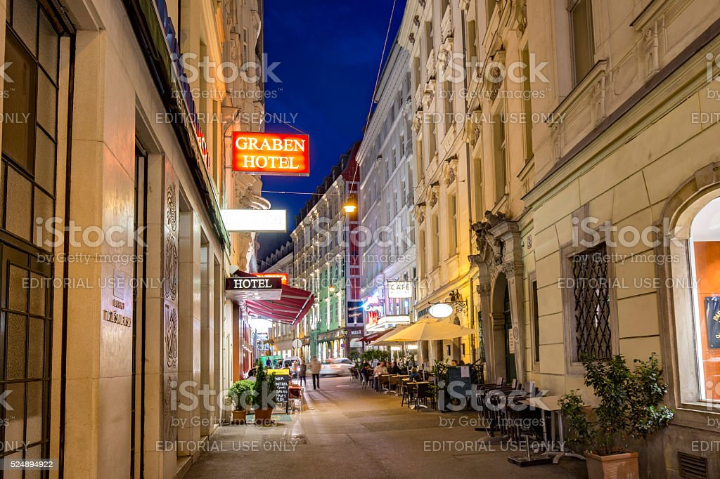 people visit Graben street in Vienna by night stock photo