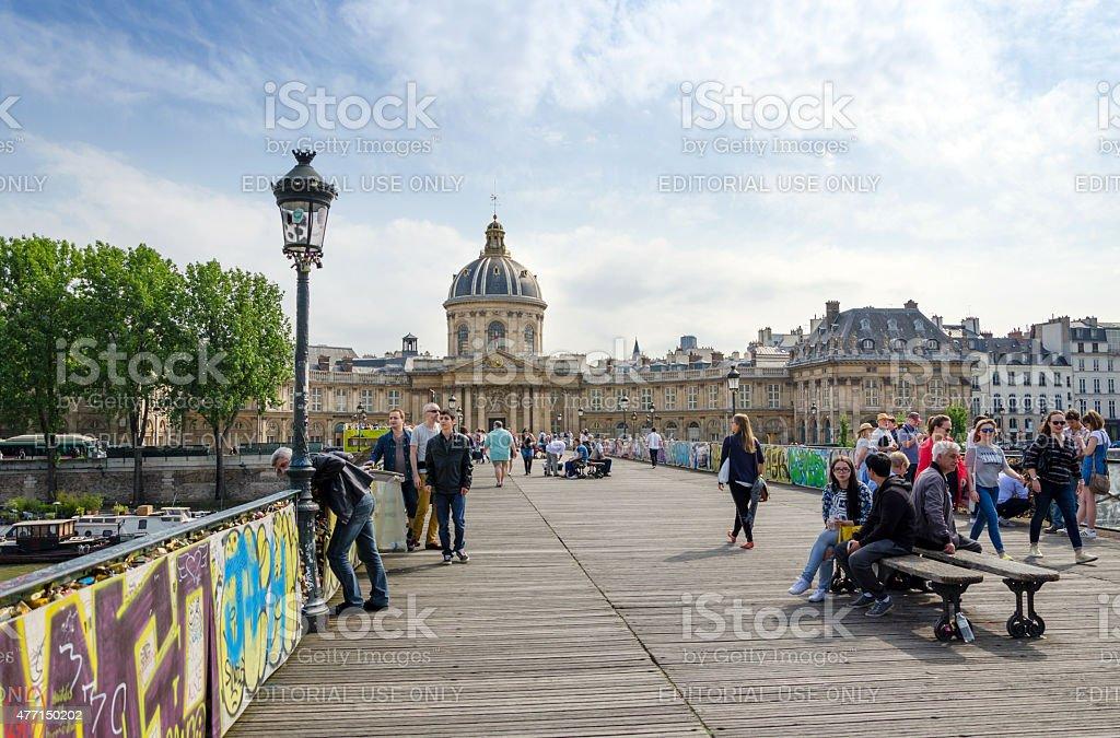 People visit Institut de France and the Pont des Arts stock photo