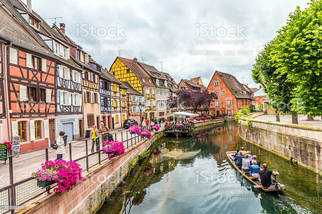 people visit little Venice in Colmar, France stock photo