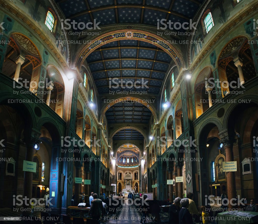 People visit local Church of Our Lady of the Snows (Chiesa di Nostra Signora della Neve). It has a beautiful interior. stock photo