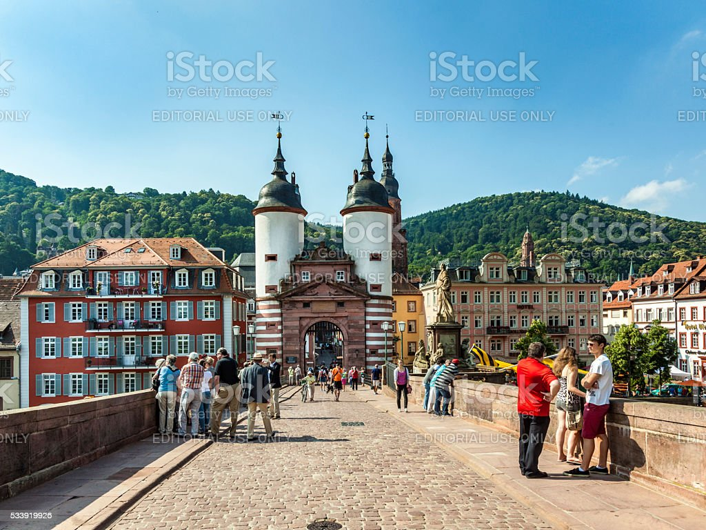 people visit old bridge and town gate  in Heidelberg stock photo