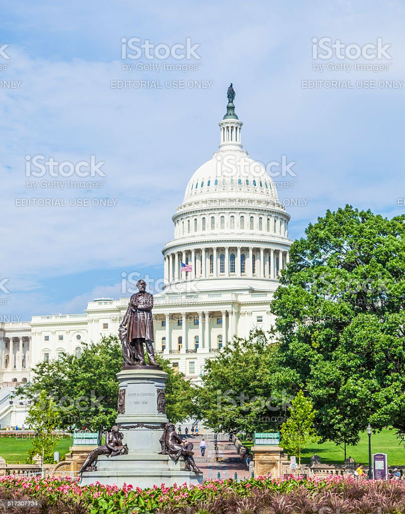 people visit the Capitol with the statue of James Garfield stock photo