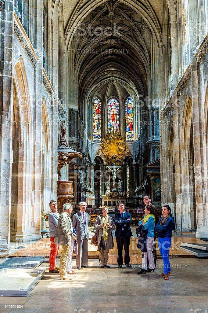 people visit the catholic church of Saint Merri in Paris stock photo