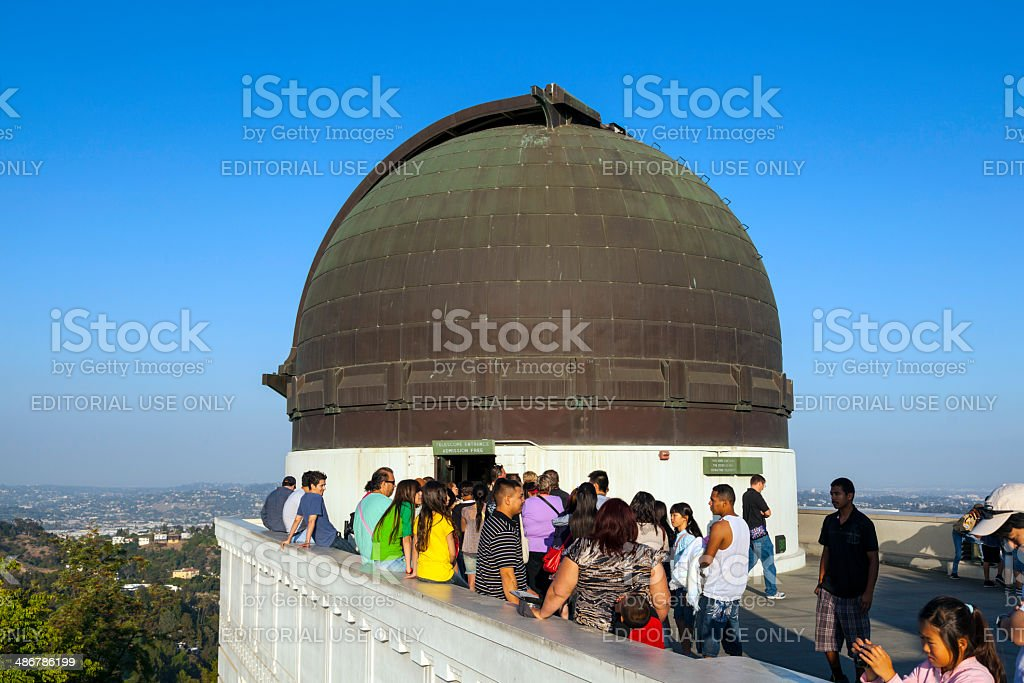 people visit the observatory in Griffith park stock photo