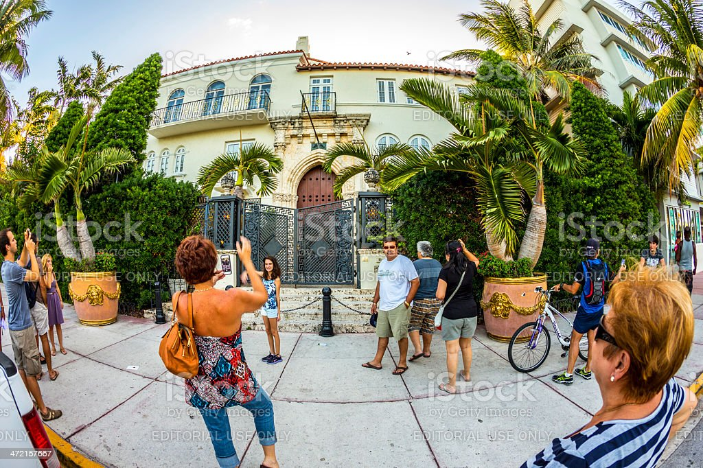 people visit the Versace mansion at ocean drive stock photo