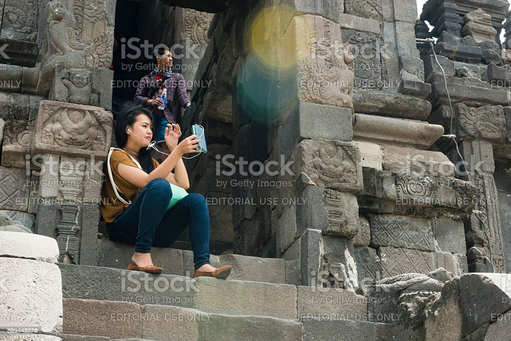 People Visiting Ancient Ruins Prambanan Temple Compound in Java Indonesia stock photo
