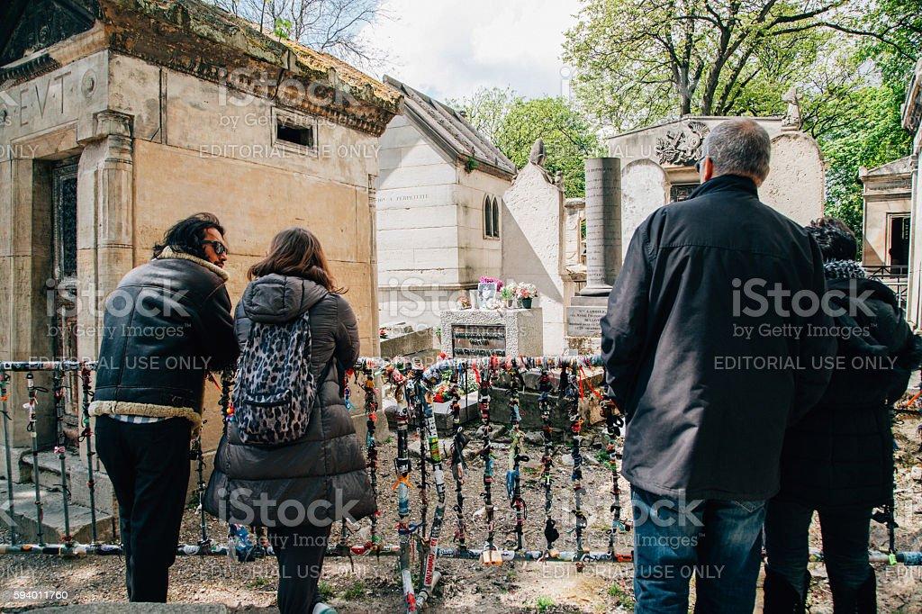 People visiting Jim Morrison's grave in Paris, France stock photo
