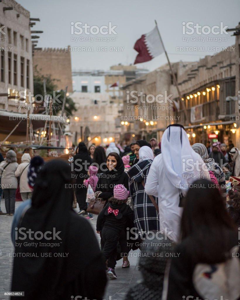 People visiting Souq Waqif in Doha, Qatar stock photo