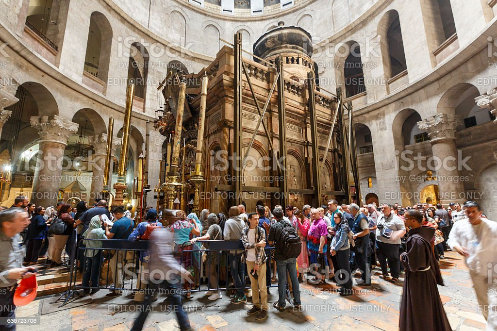 People visiting the Church of the Holy Sepulchre in Jerusalem stock photo