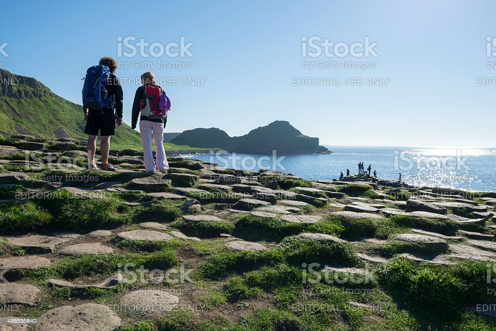 People visiting the Giant's Causeway in Northern Ireland stock photo